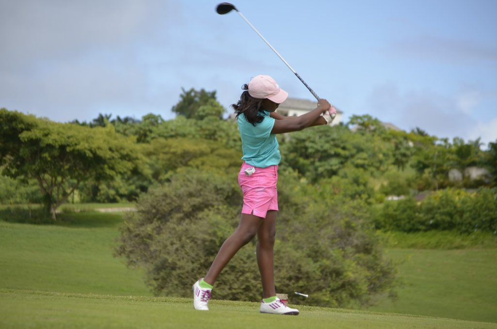 black woman playing golf