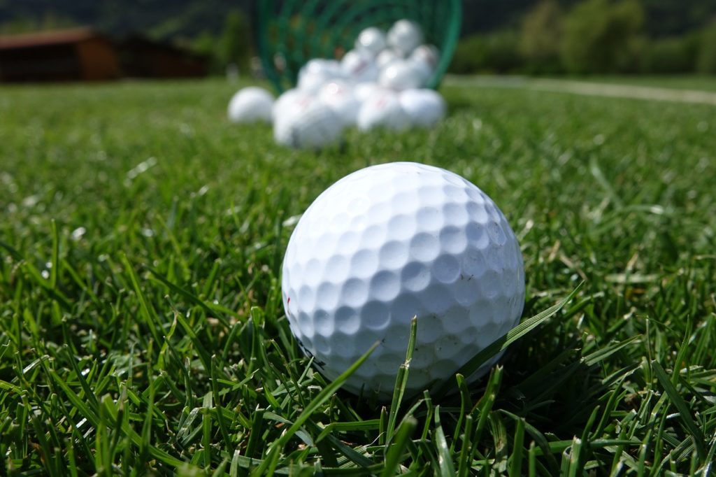 golf balls placed on the grass