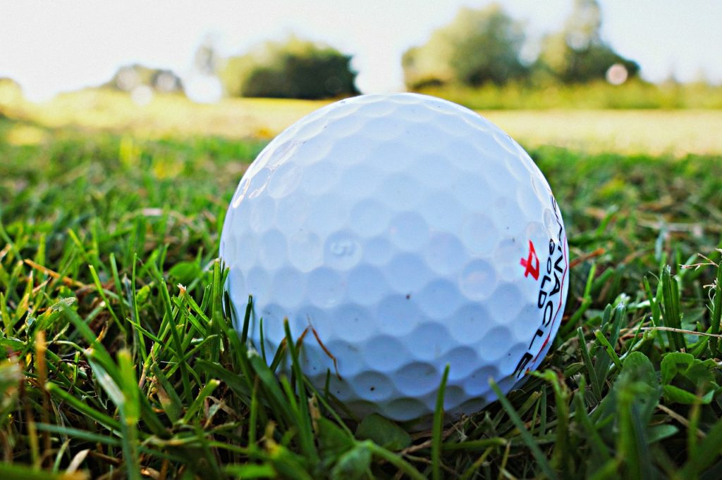 Close up photo of golf ball on the grass